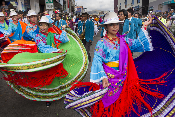 Traditional Ecuadorian dancers celebrating Mama Negra Festival in latacunga