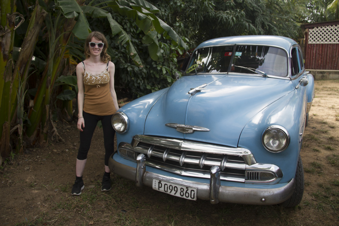 Posing in front of our old classic car from Havana to Viñales