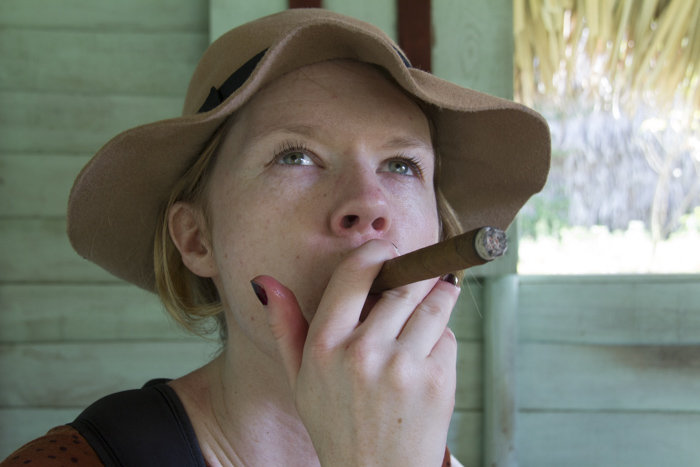 Smoking a freshly rolled cigar in Viñales, Cuba