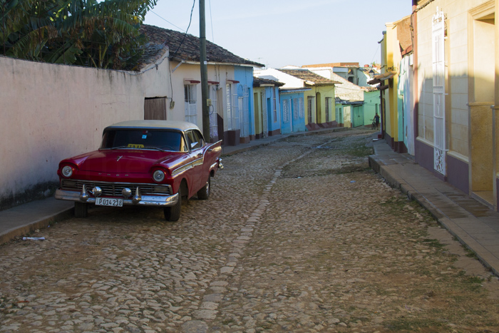 Colouful street with a classic car in Trinidad, Cuba