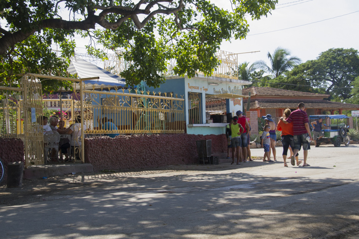 Locals hanging around the bar in La Boca, outside of Trinidad, Cuba