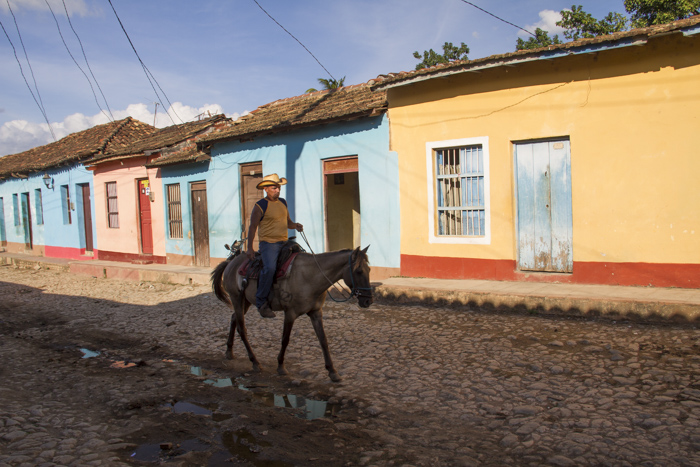 Horserider in the colourful streets of Trinidad, Cuba