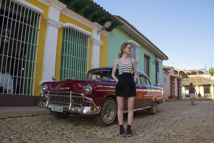 Posing in front of a classic old car in Trinidad, Cuba